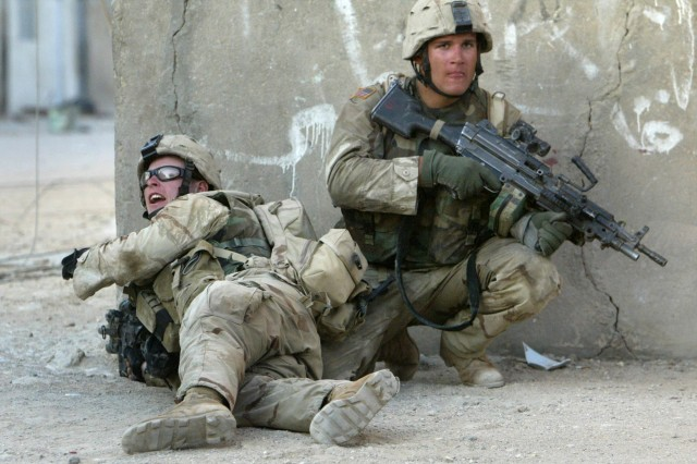 Sgt. Matthew Zedwick (left) and a fellow Soldier fight in the streets of Najaf, Iraq, Aug. 16, 2004. Sporadic but heavy fighting continued through the day and into the evening, with insurgents firing, rockets, mortars and small arms.  U.S. forces responded with tanks, Bradley fighting vehicles and helicopter air strikes. ""