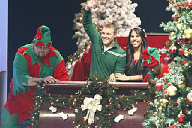 "Staff Sgt. Matthew Zedwick and wife Kristin enter the ""Deal or No Deal"" set in style. The two-hour special aired Dec. 25, 2008."""