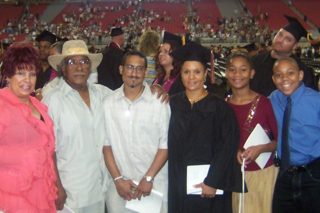 Sgt. 1st Class Tara Watson and her family pose after her graduation at the University of Phoenix stadium in Arizona. Pictured from left to right are mother Thesma Fulton, father Henry Fulton, brother Kirk Fulton, Watson and her two children, Chantell and Xavier Watson. Watson was taking online courses with the University of Phoenix when the hurricane hit and had to stop in order to take care of her family. Eventually, she was able to return to school and graduated with an associates degree in general studies, July 7, 2007. ""