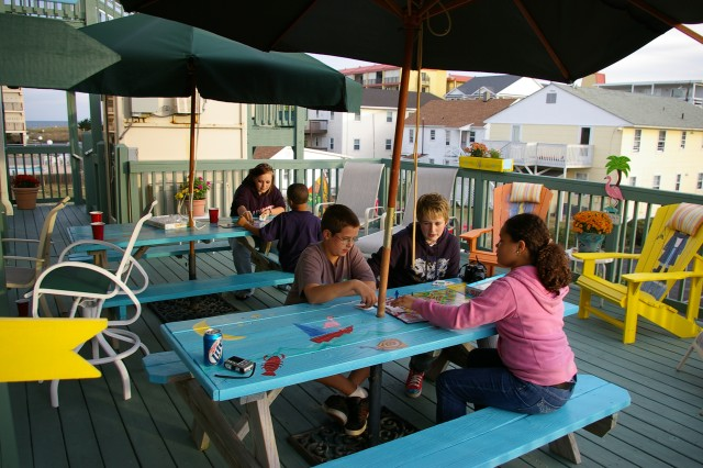 Military kids play a board game in Ocean City, Md., during a Believe in Tomorrow retreat weekend. The weekend was organized so military families with sick children could relax and bond with each other. ""