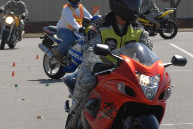 CUTLINE: Riders negotiate a simulated street layout during the first Military Sportbike RidersAca,!E+Course at Fort Leonard Wood, Mo., March 23. The course is required for all sportbike motorcycle riders on Fort Leonard Wood.