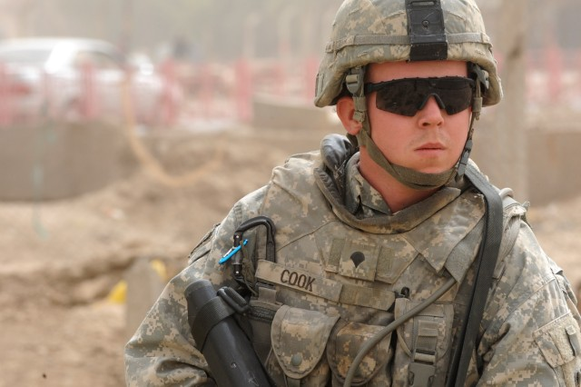 Spc. Douglas Cook, of Crockett, Texas, checks his surroundings during a route clearance operation, March 28, in eastern Baghdad.