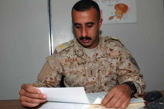 CAMP TAJI, Iraq - 2nd Lt. Bahaa Sabree Fakhre, deputy commander of the Iraqi Army medical clinic, reviews the schedule for upcoming sustainment training with the Iraqi Security Forces Partnership Team, March 19. Bahaa, who is also the dentist, has run the medical clinic on Camp Taji for three years.