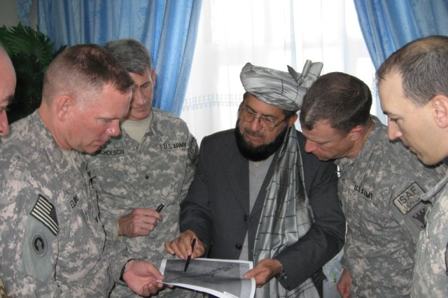 Brig. Gen. John W. Nicholson (2nd from left) and his staff meet with Provincial Gov. Del Bar Arman in Zabul, Afghanistan, to plan reconstruction projects. Meetings like this are a key element of Coalition strategy to build trust and empower Afghan leaders to meet the needs of their people.