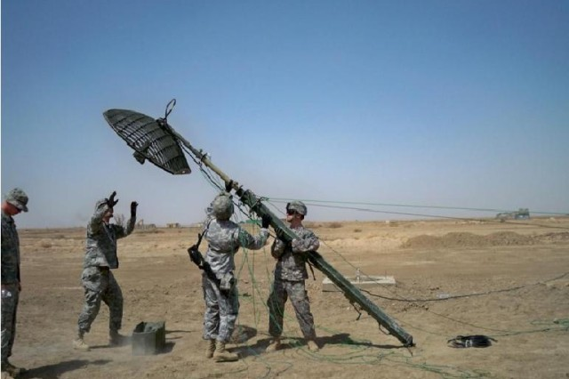Members of the 4th Special Troops Battalion, 4th Brigade Combat Team, 1st Cavalry Division train on a 15M-mast satellite dish.  The Soldiers learned how to properly install the dish to provide optimal coverage for the brigade's network communications system at Contingency Operating Base Adder, Iraq recently.