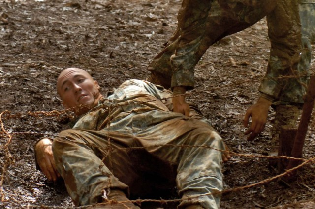 SCHOFIELD BARRACKS, Hawaii- (Mar. 27, 2009) Soldiers from U.S. Army, Pacific helped one another through the mud at the East Range obstacle course.