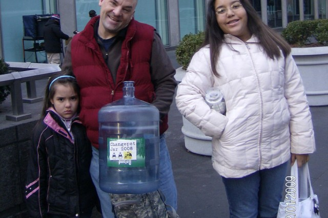 Sgt. 1st Class Scott Humphery, an Army Reserve Career Councilor, and his daughters 6-year-old Karen and 11-year-old Brianna, take a break from a family expedition to find change on the streets of New York. The family, including mother Barbara, has so far found more than $1100 in change during their expeditions -- money they say will eventually be given to charity.