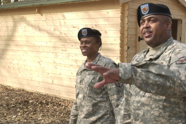 Command Sgt. Maj. Ralph Ford shows Command Sgt. Maj. Tracey Anbiya around the new training area on ChiAfA..vres Air Base.