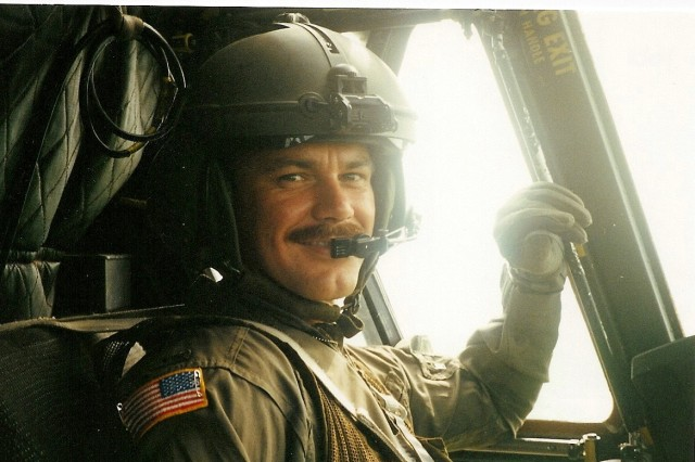 Chief Warrant Officer Dave Snow is pictured while flying a CH-47 Chinook during a mission to Haiti.