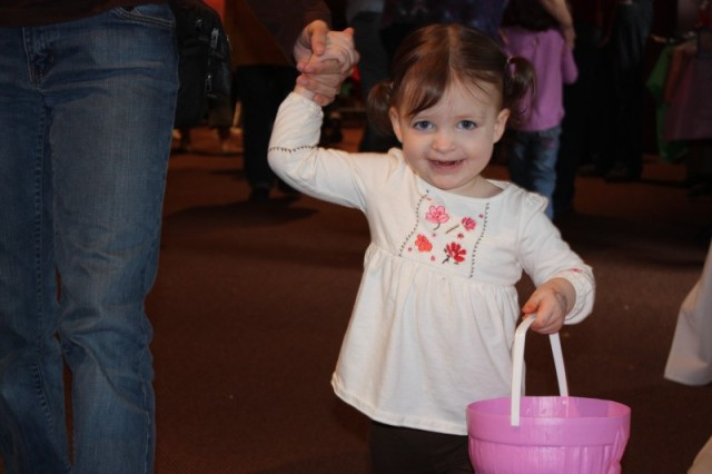 Two-year-old Emma Gillaspie searches for eggs during the EFMP Easter egg hunt.