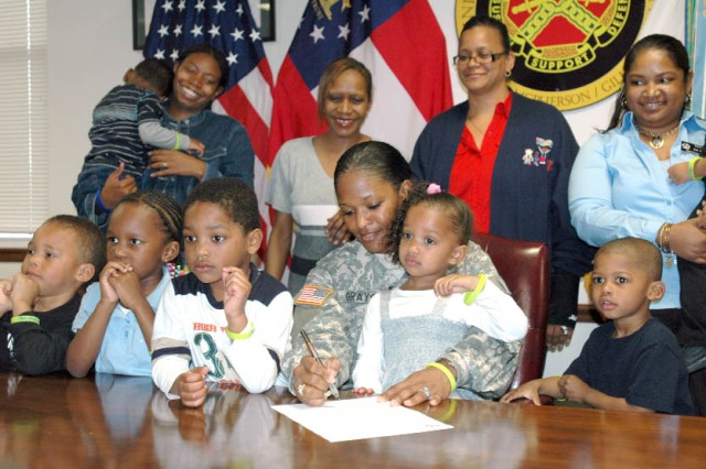 FORT MCPHERSON, Ga. -- Children from the Child Development Center's toddler through pre-K class join Col. Deborah B. Grays as she signs the Child Abuse Prevention Month proclaimaton in Bldg. 65, here, Apr. 1.  Col. Grays, the commander of U.S. Army Garrison, Fort McPherson and Fort Gillem, welcomed the children to the Commander's Conference Room to recognize April as Child Abuse Prevention Month.
