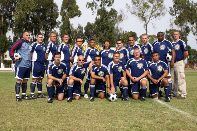 U.S. Southern Command´s Friendship Soccer Team - 2009 on the field in Lima. The SOUTHCOM team, including U.S. Army Garrison - Miami member Jill Hauser, center, visited Peru and Paraguay as part of a two-week sports outreach mission which included humanitarian efforts in local communities.