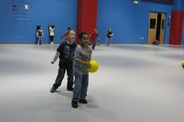 Boys and girls at the School Age Services Center run off some of their energy during a fun afternoon in the centerAca,!a,,cs multi-purpose gym. There is also room outside for the children to run and play.
