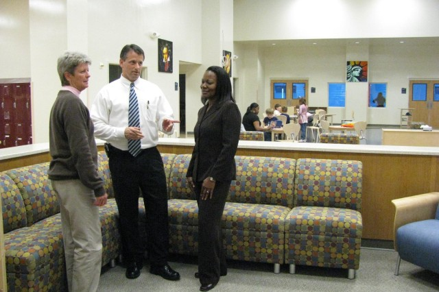 Derrick Gould, director of Family and Morale Welfare and Recreation, goes over plans for the dedication and grand opening of the new School Age Services Center with, at left, Missy Richards and Mary Washington, the center's director. The event will take place Friday at 11 a.m. The new center on Vincent Road is located on the same campus as the Child Development Center and the Youth Center. The public is invited to tour the new facility.