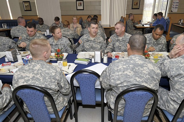 Gen. Peter W. Chiarelli, Army vice chief of staff (center), eats lunch with Fort Drum Soldiers on March 31. During his time with Soldiers, he discussed suicide prevention and ways to deal with the growing problem.