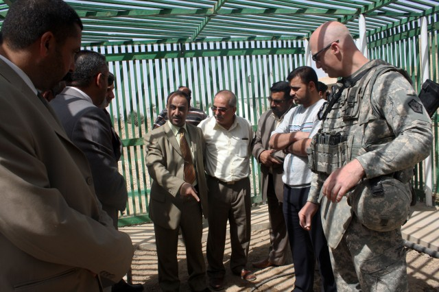 1st Lt. Devens Vogt, a civil capacity officer for 14th Engineer Battalion, listens as a politician from Dhi Qar Province in southern Iraq asks a question about the new Nasiriyah Tree Nursery during its opening ceremony March 26.