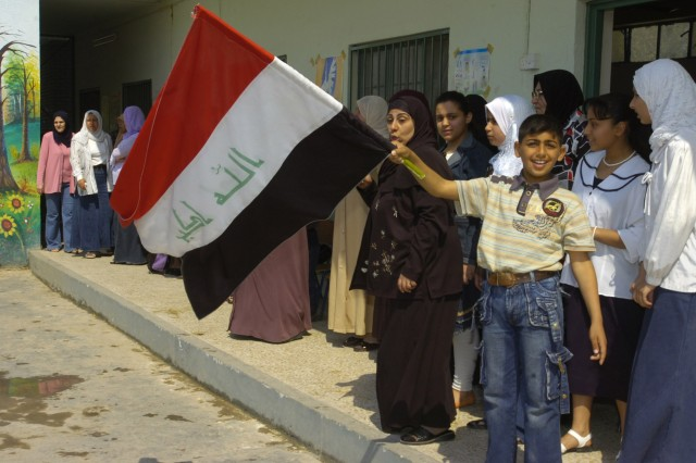BAGHDAD -An Iraqi boy waves an Iraqi flag during a distribution event April 1 in the area of Sumer al-Ghadier, located in the 9 Nissan district of eastern Baghdad. District and National Police officials handed out clothes and school supplies to more than 60 orphan children during the event. Officials invited Paratroopers assigned to the Company C, 2nd Battalion, 505th Parachute Infantry Regiment, 3rd Brigade Combat Team, 82nd Airborne Division, to participate in the event in honor of National Orphan Day.
