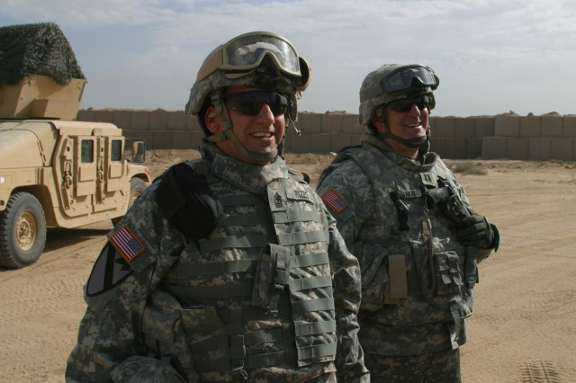 1st Sgt. Mark Rizzo, first sergeant, and Capt. Michael Tarricone, commander, Alpha Troop, 1-102nd Cavalry Squadron, 50th Infantry Brigade Combat Team, New Jersey Army National Guard, visit their Soldiers providing close base defense at Camp Bucca, Iraq on Thanksgiving Day, Nov. 27, 2008.