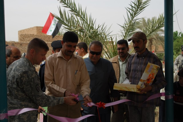 Lt. Col. Sam Whitehurst (left), commander, 2nd Battalion, 35th Infantry Regiment, 3rd Infantry Brigade Combat Team, 25th Infantry Division, and Mr. Ahmed Ali, Samarra director general of water, cut the ribbon at a ceremony commemorating the opening of a newly refurbished water treatment facility in Al Tuth village. Samarra, Iraq. Mar. 30, 2009.