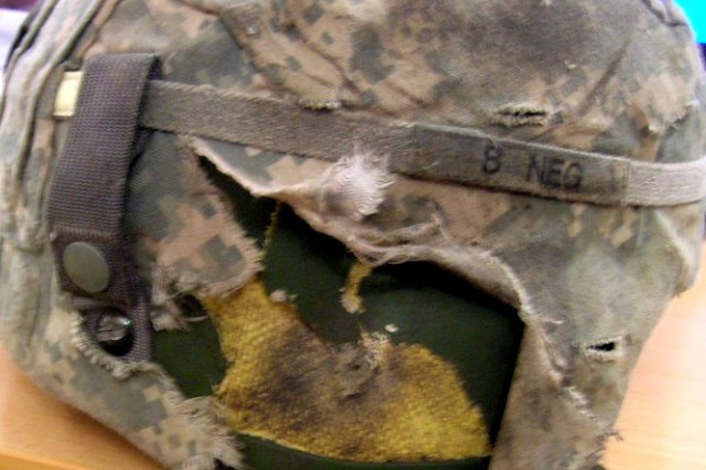 The bullet hole in the Army Combat Helmet of Staff Sgt. Matthew Harvey, a construction supervisor, with Co. E, 2nd Combined Arms Bn., 8th Inf. Regt., 2nd BCT, 4th Inf. Div., shows how his helmet saved his life Feb. 10 when he was shot during a route clearance mission in Najaf.