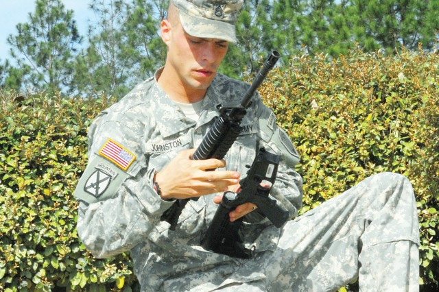 SSG Michael Johnston assembles one of three weapons whose parts were mixed inside the same bag.  This was one of four tasks the NCOs completed March 24 on Sand Hill, hoping to earn the title of Drill Sergeant of the Year.