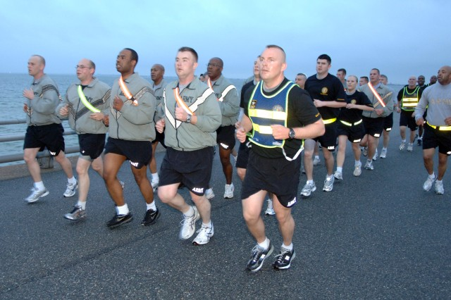 A platoon of Soldiers from Fort Monroe, Va., runs along the installation's seawall while participating in the April 3 NCO Day run organized by Headquarters, U.S. Army Training and Doctrine Command. The Year of the NCO tribute also included a mid-morning briefing that included introductory remarks by Lt. Gen. David P. Valcourt, TRADOC Deputy Commanding General; a history of the NCO Corps talk by Sgt. 1st Class Michael Noland, 2008 U.S. Army Drill Sergeant of the Year; and the showing of the NCO-tribute video recently released by Sergeant Major of the Army Kenneth O. Preston.