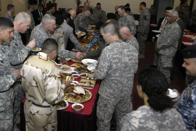 BAGHDAD - Guests enjoy a buffet of traditional Iraqi and American food while at the Mada'in Farewell Luncheon held at Freedom Rest hosted by the 2nd Brigade Combat Team, 1st Armored Division, Multi-National Division - Baghdad, April 1. The Iron Brigade officially handed over the Mada'in Qada southeast of Baghdad after 11 months of operations to the 3rd Brigade Combat Team, 82nd Airborne March 31.