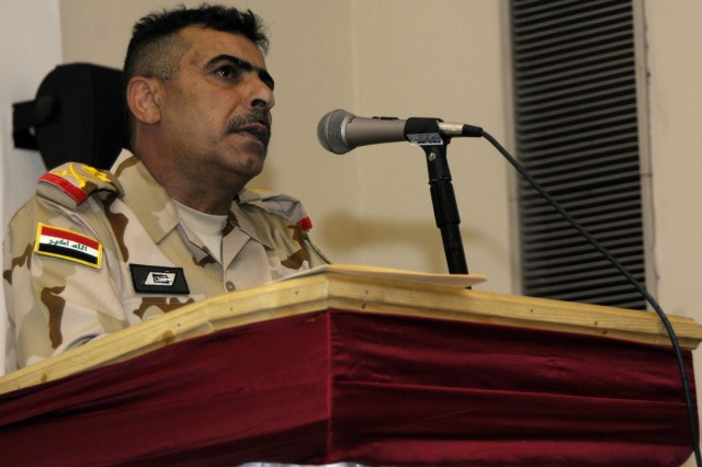 BAGHDAD - Staff Maj. Gen. Qassim Jassem Nazal commander of the 9th Iraqi Army Division, speaks to the guests of the Mada'in Qada Farewell Luncheon, hosted by the 2nd Brigade Combat Team, 1st Armored Division, Multi-National Division - Baghdad, April 1. The Iron Brigade officially handed over the Mada'in Qada southeast of Baghdad after 11 months of operations to the 3rd Brigade Combat Team, 82nd Airborne March 31.