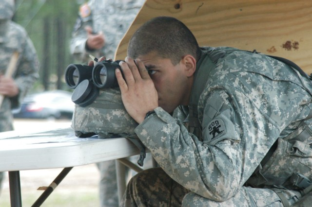 A Soldier of the 1st Battalion (Airborne), 509th Infantry Regiment, determines the distance to a target.