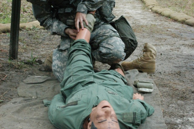 A Soldier of the 1st Battalion (Airborne), 509th Infantry Regiment, demonstrates his knowledge of first aid during the Expert Infantryman Badge test March 25
