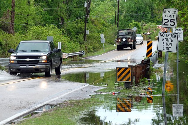 The Louisiana National Guard prepares to help protect property and ensure public safety of  citizens in St. Tammany Parish after heavy rains flooded areas along the southeast border of Louisiana and Mississippi near the town of Pearl River, April 2.