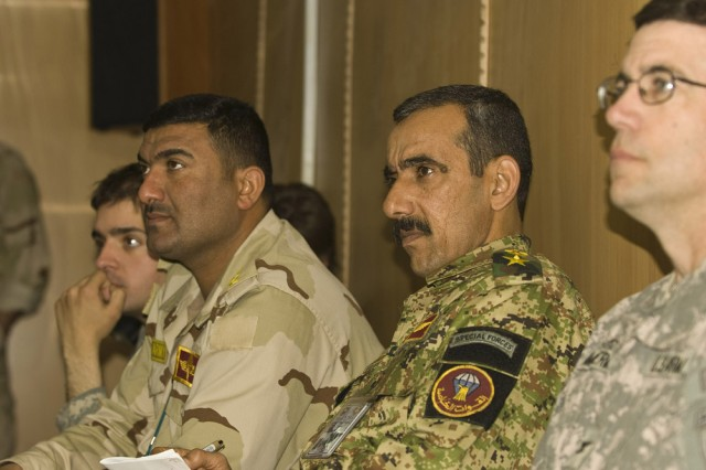 "Listening closely to the briefings by the students are (left to right): Iraqi army capt. Kahar Hamse, the chief Counter-Insurgency Academy instructor; Iraqi army Lt. Col. ""Ahmed,"" the training director for the COIN academy; and Col. Daniel R. Ammerman, U.S. Army Reserve commander of the 304th Civil Affairs Brigade. Iraqi students learned basic civil military operation procedures and had to apply them through various practical exercises and briefings. Over 37 Soldiers and policemen from all regions of Iraq participated in the week-long course which culminated by groups briefing the class, and the commanders on their projects. This Army Reserve brigade which is composed of Warrior citizen soldiers from the Philadelphia area, are part of the U.S. Army Civil Affairs and Psychological Operations Command (Airborne), headquartered at Fort Bragg, N.C."""