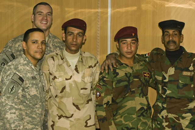 Non-commissioned officers are the backbone of the U.S. Army, and with this influx of newly trained Iraqi NCOs, it will soon be a foundation of the Iraqi army as well. Posing with their students are two members of the 304th Civil Affairs Brigade, Army Reserve Sgt. First Class Axel Acosta (left), and behind him, Staff Sgt. Matthew Johnson. The Iraqi NCOs to the right are recent graduates of the first Iraqi Civil Military Operations Non-commissioned Officers Course. Iraqi students learned basic civil military operation procedures and had to apply them through various practical exercises and briefings. Over 37 Soldiers and policemen from all regions of Iraq participated in the week-long course which culminated by groups briefing the class, and the commanders on their projects. The 304th Civil Affairs Brigade is composed of Warrior Citizen Soldiers from the Philadelphia area, and are part of the U.S. Army Civil Affairs and Psychological Operations Command (Airborne), headquartered at Fort Bragg, N.C.""