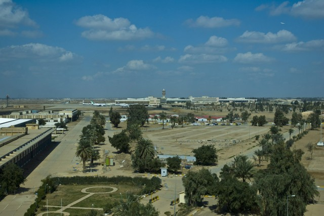 A scenic view of the Baghdad International Airport from the top of the new Iraqi Airways International Business Center in the BIAP complex. From this view one can see the future convention center on the left and the hotel (red roofs) in the center. The area is also being developed for other investments In the future. The 304th Civil Affairs Brigade, whose Soldiers as assisting with the economic development of the area, are an Army Reserve brigade composed of Warrior Citizen Soldiers from the Philadelphia area, and are part of the U.S. Army Civil Affairs and Psychological Operations Command (Airborne), headquartered at Fort Bragg, N.C.""