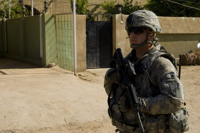 Army Reserve Soldiers with the 304th Civil Affairs Brigade patrol the streets of Mahawil, a city southwest of Baghdad, Iraq on March 18. Staff Sgt. Joseph Norcini, the assistant personal security detail non-commissioned officer in charge, scans the local market for any possible threats. This Army Reserve brigade, is composed of Warrior Citizen Soldiers from the Philadelphia area, and are part of the U.S. Army Civil Affairs and Psychological Operations Command (Airborne), headquartered at Fort Bragg, N.C.""