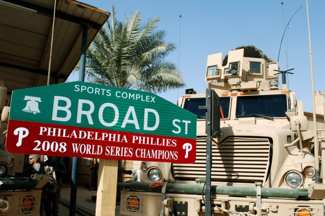 Being hundreds of miles away did not deter these die hard Philadelphia Phillies fans from having one of Camp Slayer's streets renamed to honor their team. 1st Sgt. David M. Bernosky, with the 304th Civil Affairs Brigade, helped coordinate the project to boost moral for the Philadelphia based unit and to remind everyone in the Baghdad region who won the World Series. This Army Reserve brigade, composed of Warrior Citizen Soldiers from the Philadelphia area, are part of the U.S. Army Civil Affairs and Psychological Operations Command (Airborne), headquartered at Fort Bragg, N.C. ""