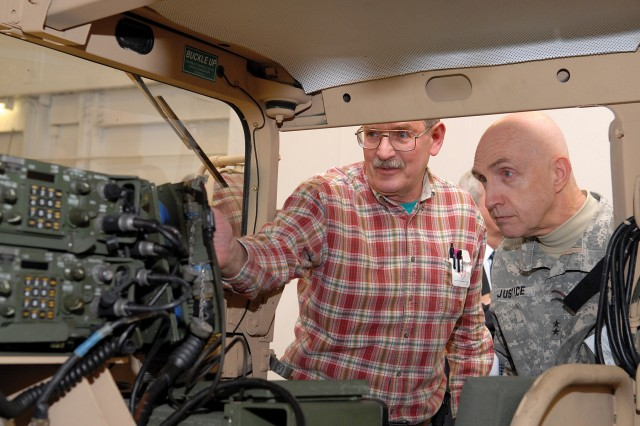 John Morris demonstrates a Blue Force Tracking system to Maj. Gen. Nickolas Justice on March 17.  Justice toured depot facilities and was briefed on several depot missions, and the Depot Maintenance of the Future program.  Morris is an electronic digital computer mechanic leader in the Command, Control and Computer Systems/Avionics Directorate.