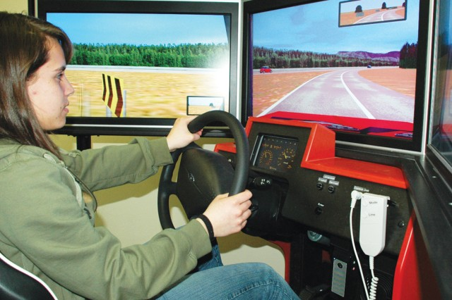 Kaila Garst takes a spin in a driving simulator during a driver education theory class last month. The class fulfills the 50-hour driver education requirement demanded by most stateside agencies that issue driver's licenses.