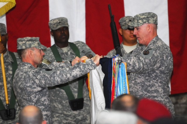 Lt. Gen. Charles H. Jacoby, left, commander of 1st Corps, and Command Sgt. Maj. Frank Grippe of 1st Corps, uncase the Corps' colors during a ceremony in which Lt. Gen. Lloyd J. Austin III, commander of 18th Airborne Corps, relinquished command of Multinational Corps Iraq to Jacoby. The ceremony took place at Al Faw Palace, Camp Victory, Iraq, April 4, 2009.