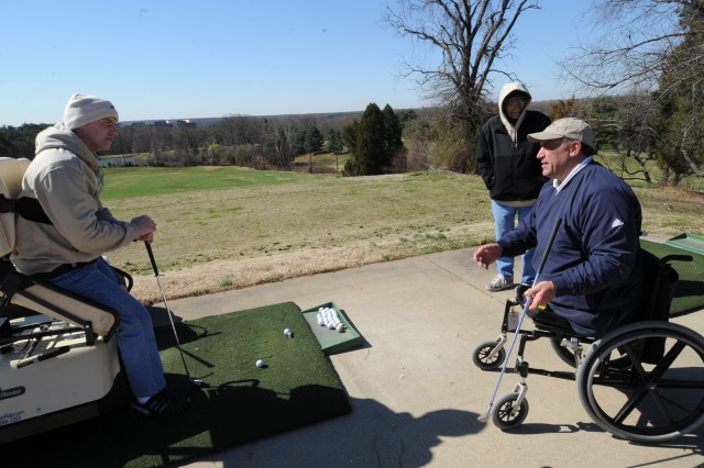 """Sgt. Roy Mitchell (left) receives pointers from First Swing instructor Marty Ebel (right), who lost both his legs after flipping a front-end loader in a landscaping accident, while Mitchell's father, Roy, listens. """"I think this is one of the best programs the Army has come up with as far dealing with Soldiers' physical and psychological injuries,"""" said the elder Mitchell, who did two tours of Vietnam while serving from 1963 through '70. """"It was neglected for a while. When I was in the Army, we didn't have anything like this."""""""