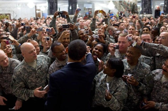"President Barack Obama shakes hands with hundreds of U.S. troops during his April 7, 2009, visit to Camp Victory, Iraq. ""You have performed brilliantly in every mission that has been given to you. You've kept your eyes focused on just doing your job,"" Obama told the troops."