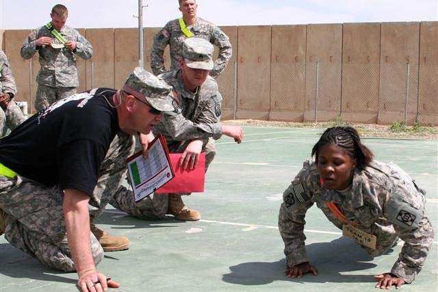 Female Soldier pushes herself and others