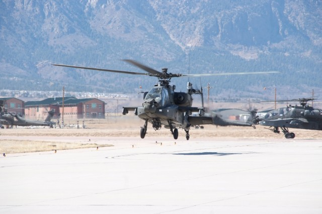 FORT CARSON, Colo.-An AH-64 Apache attack helicopter with the 1st Battalion, 2nd Aviation Regiment, 2nd Infantry Division, prepares to land at Fort Carson's Butts Army Airfield April 6. Twelve of the 1-2nd AVN's 24 Apaches arrived at Fort Carson as part of the unit's restationing to the Mountain Post from Camp Eagle, Wonju, Republic of Korea. When the move is complete, the unit will bring about 350 Soldiers and 100 contractors to Fort Carson.