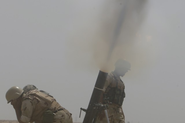 BAGHDAD- Soldiers from the 17th Iraqi Army Division fire 120 mm mortars during a combined arms live-fire exercise, air assault operation, and crowd control procedures at the Qaqa' weapons facility south of Baghdad April 6.  The exercise was to demonstrate the division's proficiency in combined operations to key Minister of Defense and Iraqi Security Forces leadership. The 17th IA Div., has been in partnership with the 2nd Brigade Combat Team, 1st Armored Division for the past six months training and conducting combined operations.