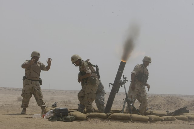 BAGHDAD- Soldiers from the 17th Iraqi Army Division fire 120mm mortars during a combined arms live-fire exercise, air assault operation and crowd control procedures at the Qaqa' weapons facility south of Baghdad April 6.  The exercise was conducted to demonstrate the division's proficiency in combined operations to key Minister of Defense and Iraqi Security Forces leadership. The 17th IA Div. has been in partnership with the 2nd Brigade Combat Team, 1st Armored Division for the past six months, training and conducting combined operations.