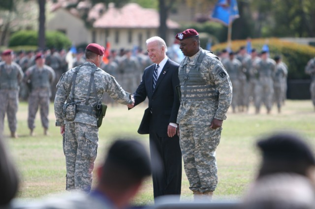 Vice President Joe Biden shakes hands with Brig. Gen. Dan Allyn, XVIII Airborne Corps chief of staff, after the pass and review with Lt. Gen. Lloyd J. Austin, III, XVIII Airborne Corps and Fort Bragg commanding general at the Corps' welcome home ceremony Wednesday at the Fort Bragg Main Post Parade Field.