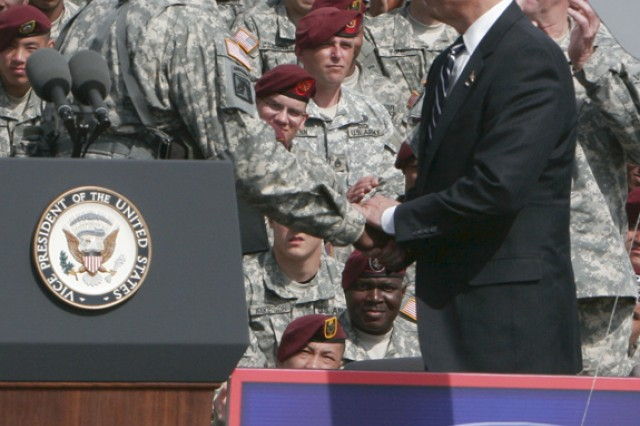 Vice President Joe Biden shakes hands with Lt. Gen. Lloyd J. Austin III, commanding general of XVIII Airborne Corps and Fort Bragg, at the Corps' welcome home ceremony Wednesday at the Fort Bragg Main Post Parade Field.