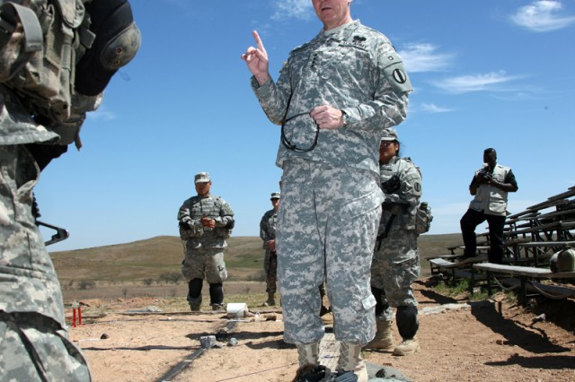 Gen. Martin E. Dempsey, commanding general of the U.S. Army Training and Doctrine Command, talks with lieutenants in the Basic Officer Leader Course II April 8, at the Thompson Hill range at Fort Sill, Okla. Dempsey visited the fort April 8-9 for an orientation to its missions. He has been the TRADOC commander at Fort Monroe, Va., since December 2008.