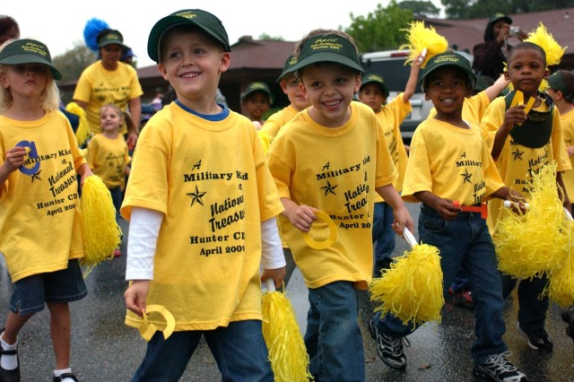 Children walked in celebration of Month of the Military Child in a kick-off parade at Hunter Army Airfield's Child Development Center, April 1. More than 300 people participated despite an early torrent of showers.