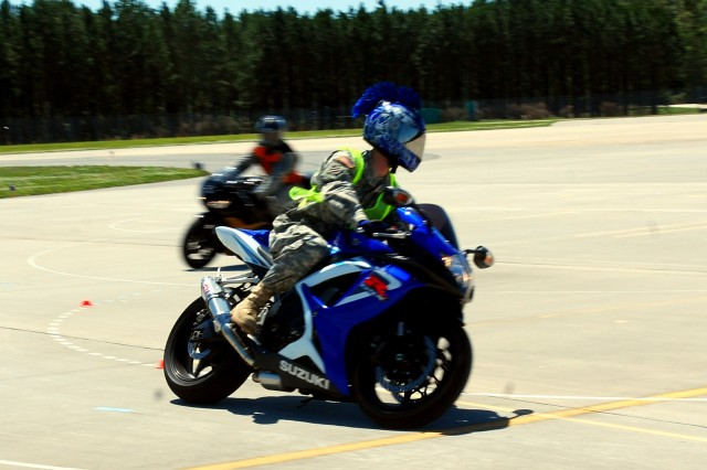 Chief Warrant Officer Josh Dellavecchia, B. Co., 4/3 Avn., prepares to drive through a lane designed to train motorcycle riders how to manage turns during motorcycle safety training at Hunter Army Airfield, April 3.